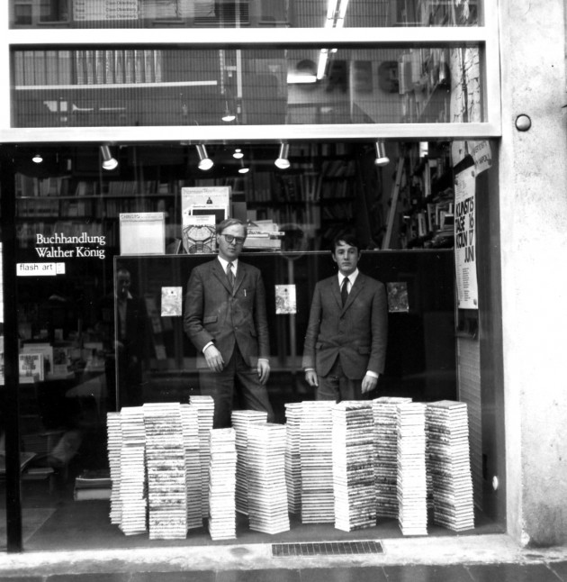 Gilbert and George performing in the window display at Buchhandlung Walther König in Cologne, 1971